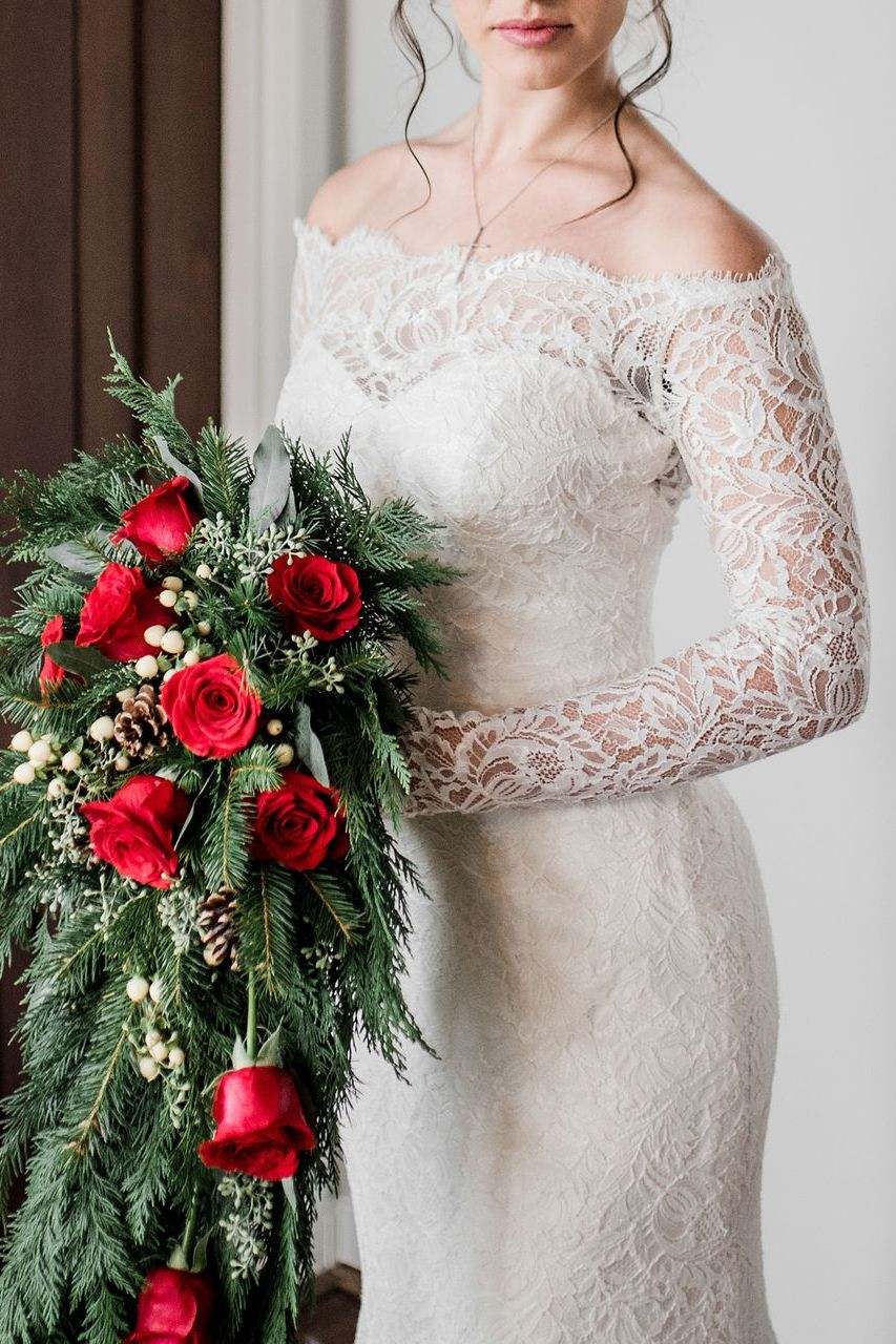 Long Sleeve Lace Wedding Dress A Huge Overflowing Rose Bouquet