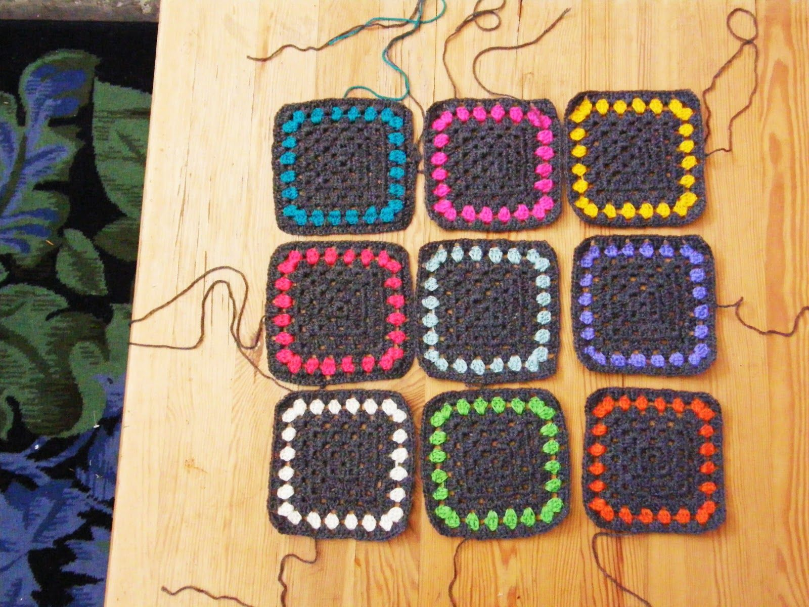 granny squares ~ I love how the use of black makes the contrasting ...