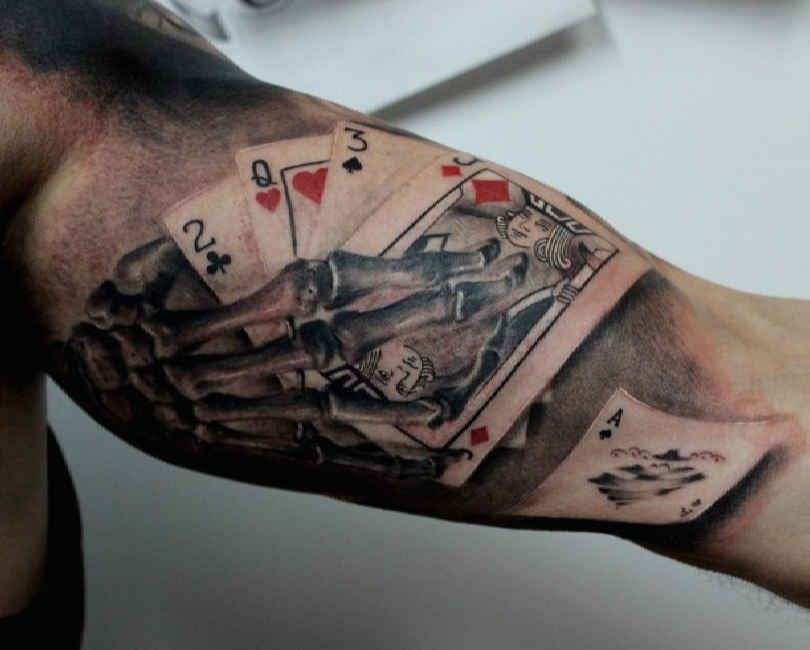 upper arm tattoo playing cards skelet. Black Bedroom Furniture Sets. Home Design Ideas