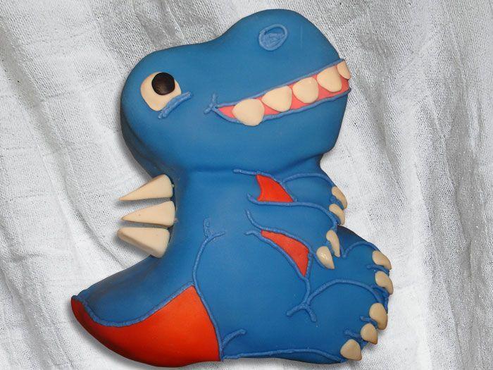 Dinosaur Birthday Cake Using the Wilton Dinosaur cake pan as a