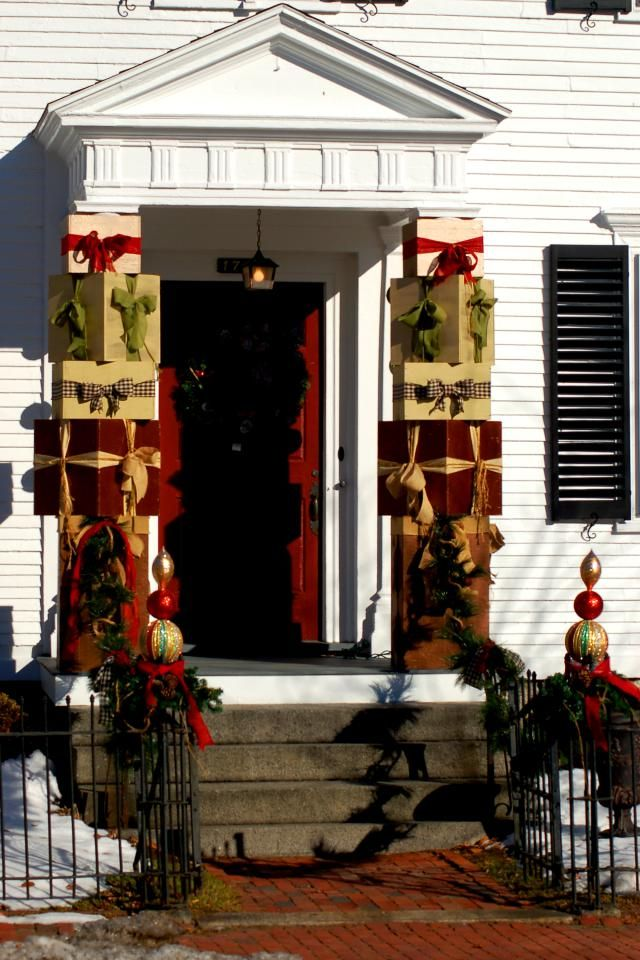 tired of tacky christmas decorations porch columns decorated with christmas gift boxes