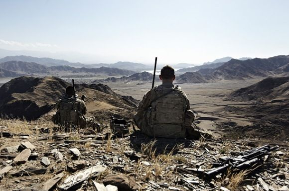 In Afghanistan's Nangahar province, U.S. Army soldiers from Task Force Mountain Warrior rest during a reconnaissance mission aimed at locating the paths used by insurgents between Afghanistan and Pakistan, June 3, 2012. (Photo by Sebastiano Toma/SIPA.)