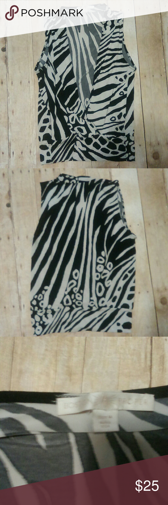 """Boston Proper Sleeveless Wrap Top Size M -Sleeveless faux wrap top - Black and white animal print -Size medium -95% polyester and 5% Spandex -Armpit to armpit measures at 22"""" -Length from shoulder to hem is 26"""" -Comes from a smoke and pet free home Boston Proper Tops"""