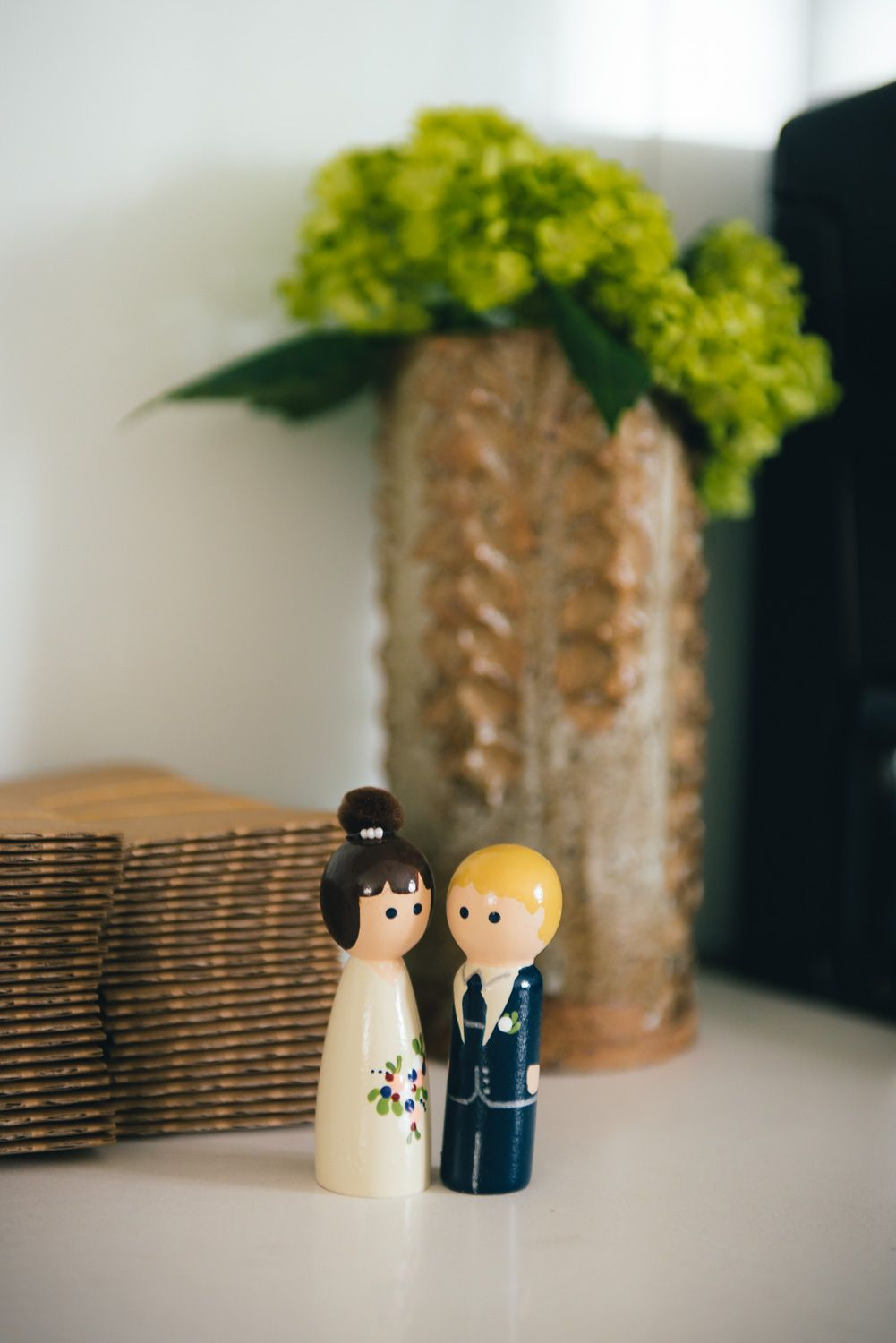 Cute wedding cake topper of bride and groom wedding day details