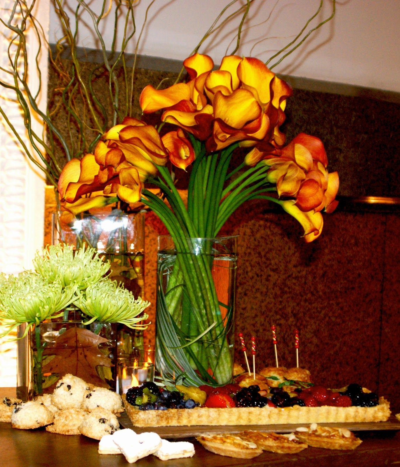 West collects philadelphia reception flower arrangement of cala west collects philadelphia reception flower arrangement of cala lily and spider mum by leslie grayson izmirmasajfo