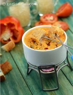 The delectable flavour of flame-roasted tomato and capsicum makes this a unique dip, which all your guests are sure to woo. Serve this with toasted croutons and be prepared to take a million calls from your guests the day after the party, asking for the recipe!