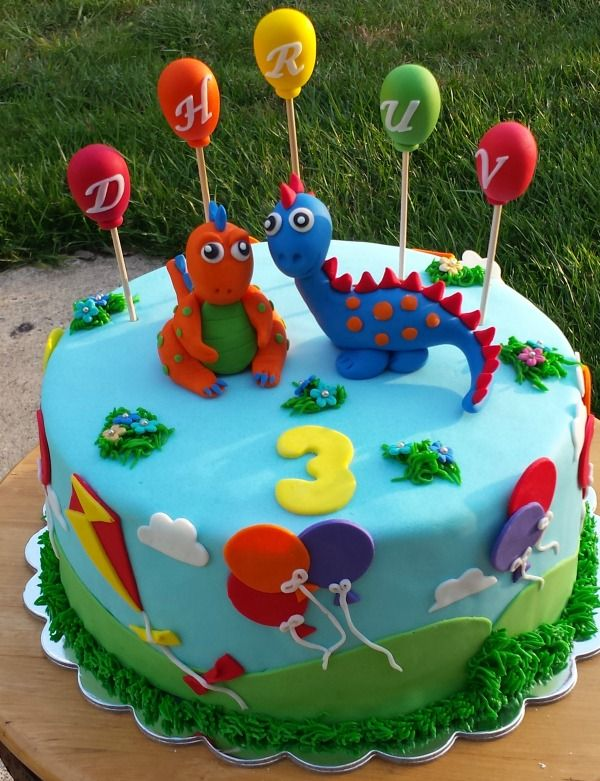 Dinosaur themed cake. Birthday cake with balloons ...