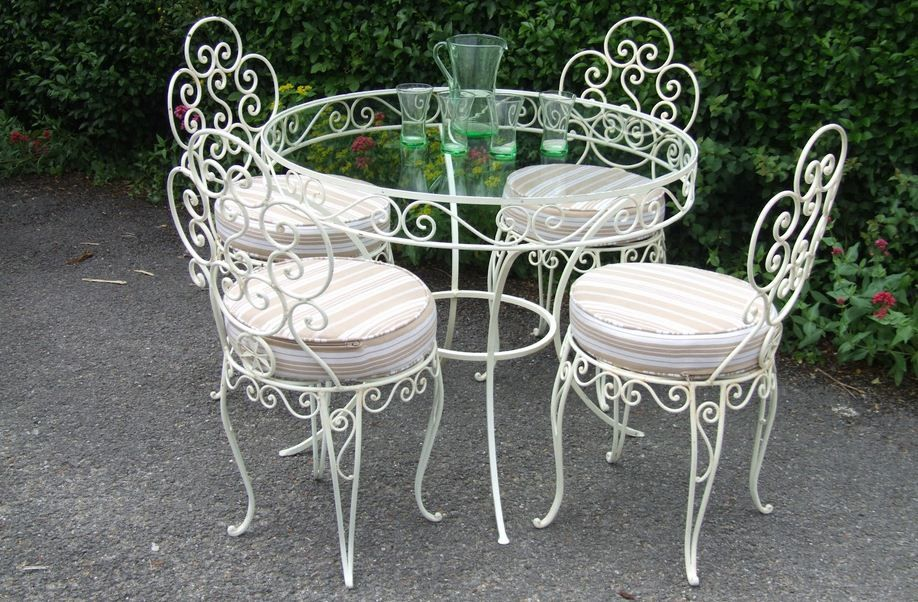 wrought iron furniture with glass top table
