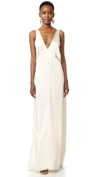 A fluid Giada Forte maxi dress with a hint of lustrous sheen. The V neckline and back create a refined, flirty look. Sleeveless. Unlined.