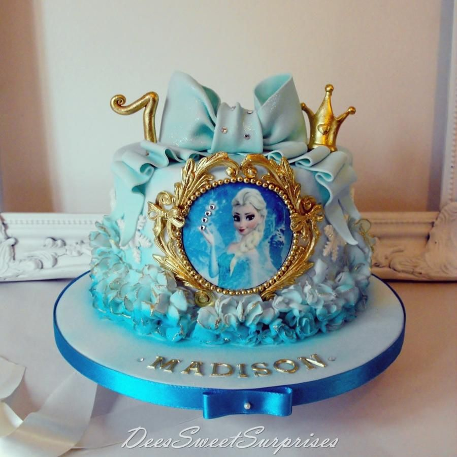 Single tier Frozen themed birthday cake the ruffles were white and