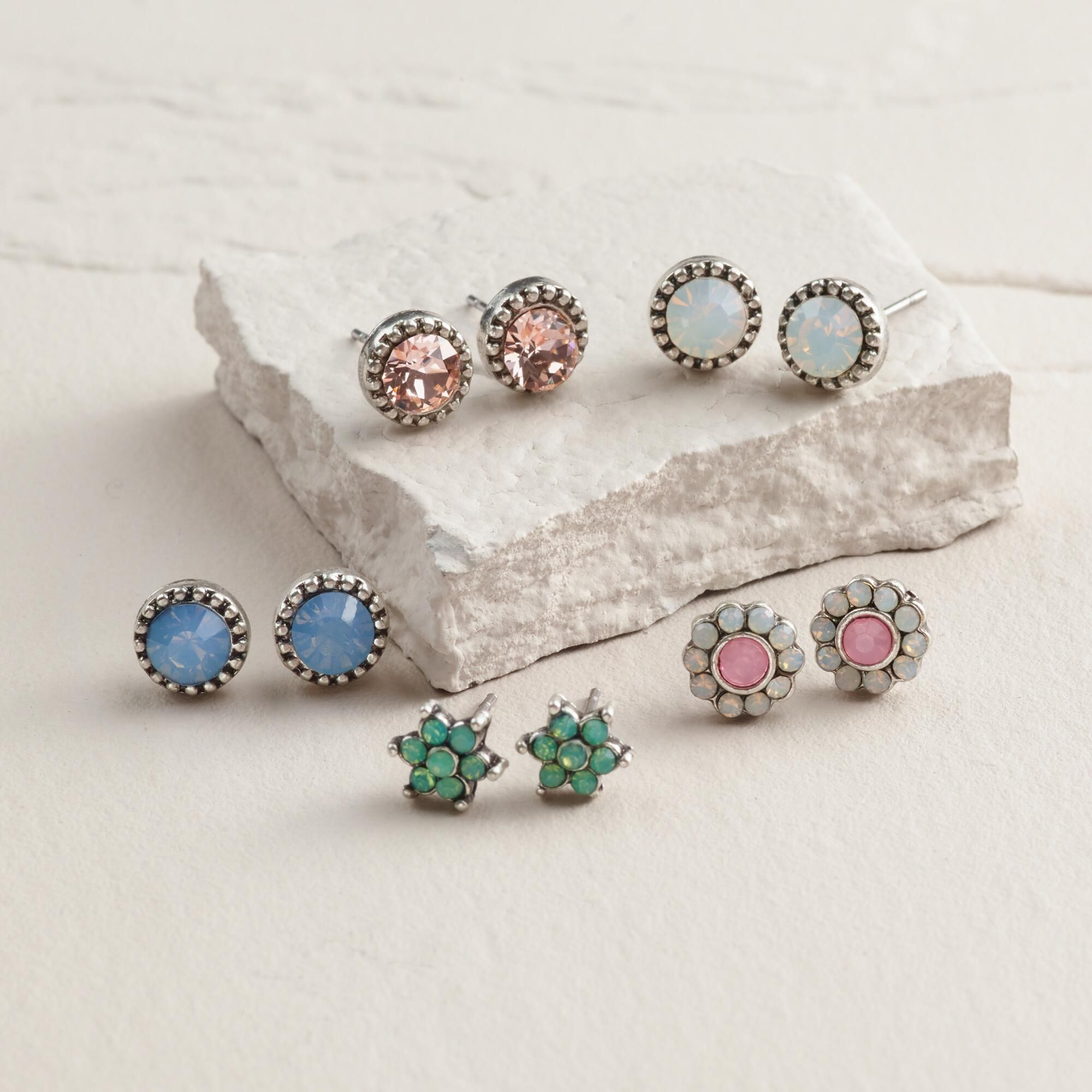 Featuring an array of opalescent designs with sparkling detail, our assorted earrings possess an ethereal spirit making them fun to mix and match.