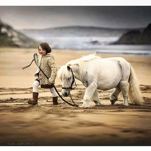 A walk along on the beach in Ireland, where surely the selkie rise up from the sea to glimpse a magical tiny horse. Captured by Moscow based photographer @elena_shumilova
