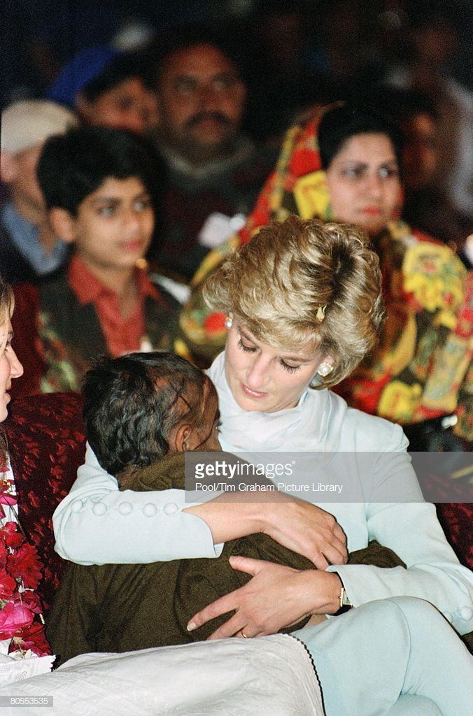 Diana, Princess of Wales with a young pakistani child on