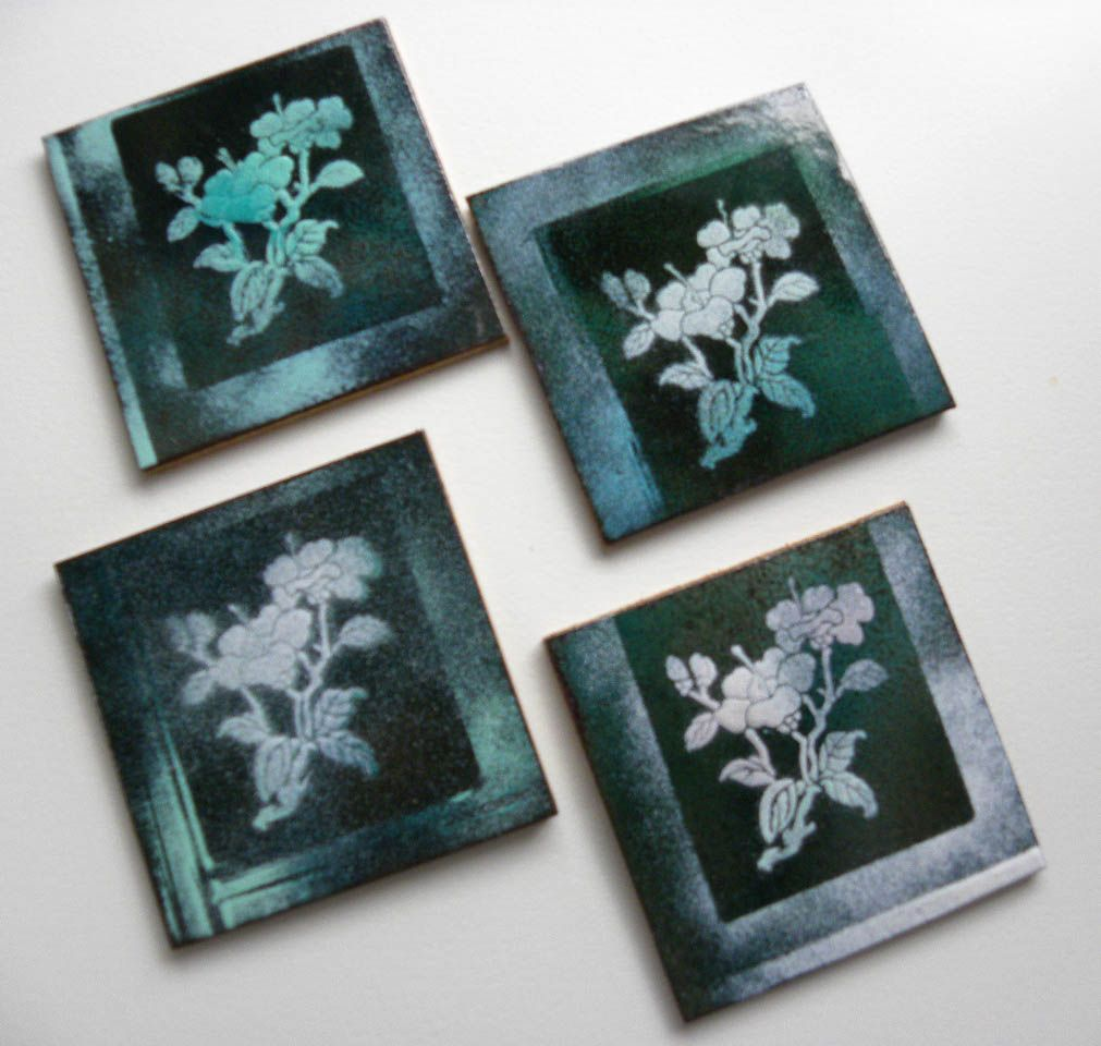 set of enamelled copper coasters, backed with cork - Jackie Simmonds