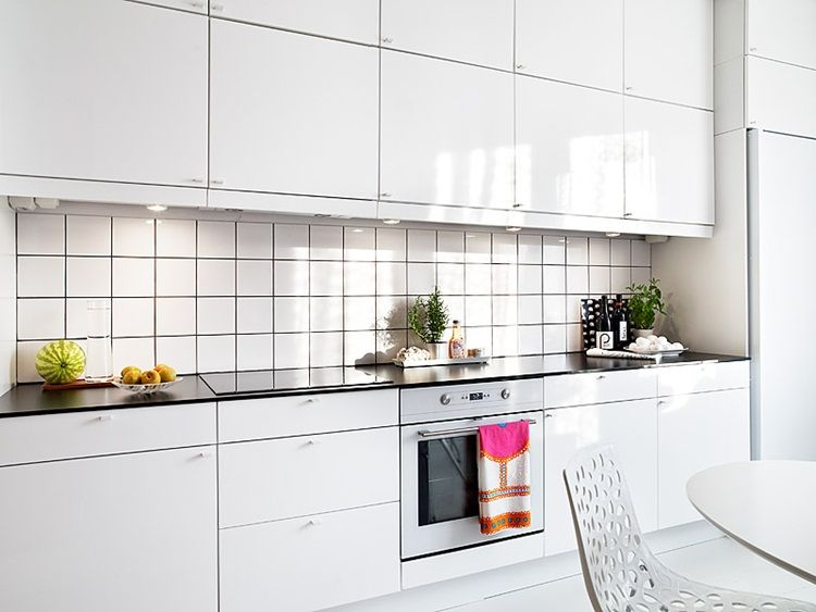 kitchen white cabinets and floor black counter white tile dark - kleine k che l form