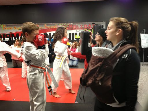 Black Belt Karate Studio of Racine, WI teaches Karate, Martial Arts, and Cage Fitness to men, women, and children.  Building Champions in Life!  Call us at 262-554-7431 to schedule your first lesson.  Black Belt Karate Studio, Karate, Racine, Martial Arts, Kids Karate, Kids Martial Arts, Kids Karate Racine, Fitness Racine, Racine Fitness, MMA Fitness Racine, Kickboxing Racine, Racine Kickboxing, Fitness Kickboxing Racine, Karate Racine, Racine MMA, Adult Karate, Adult Karate Racine