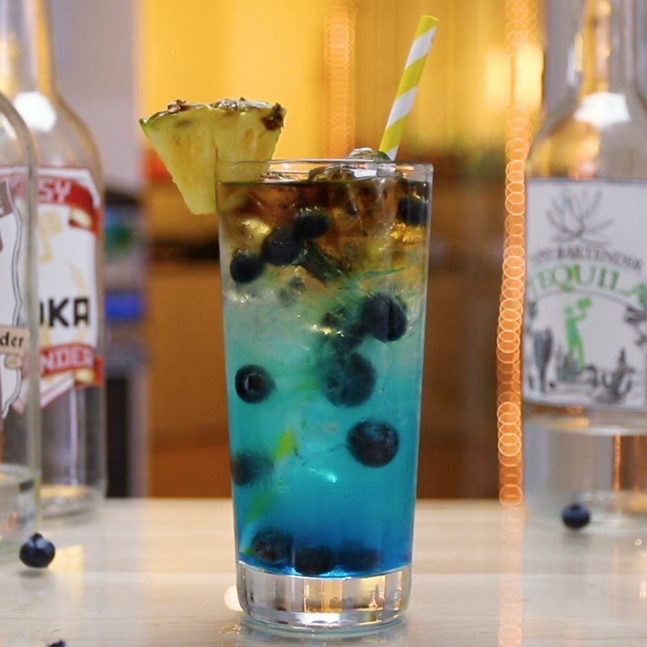Blue Jamaican Long Island Tipsy Bartender Recipe In 2021 Tipsy Bartender Long Island Iced Tea Recipe Rum Cocktail Recipes