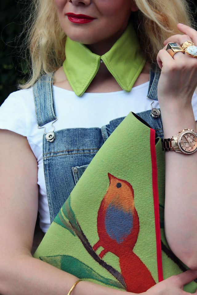 green collar and over sized clutch