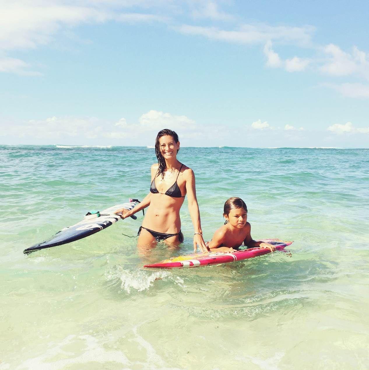 Malia Jones surfing