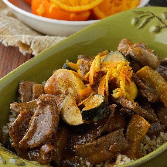 Gluten Free Orange Beef Stir Fry in a citrusy and tangy orange soy sauce with loads of zucchini and yellow squash. The perfect 30 minute Asian cuisine.