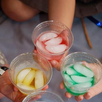 Dry food coloring in bottom of glass, add ice, add water, get your ...