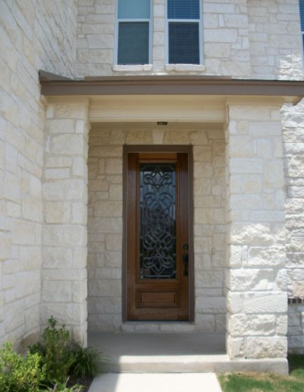 Decorative Gl And Wood Door On A White Stone House Makes Beautiful Statement Front Entry