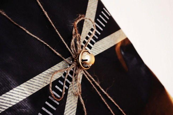 Black Gift Wrap Gold Bell Remodelista