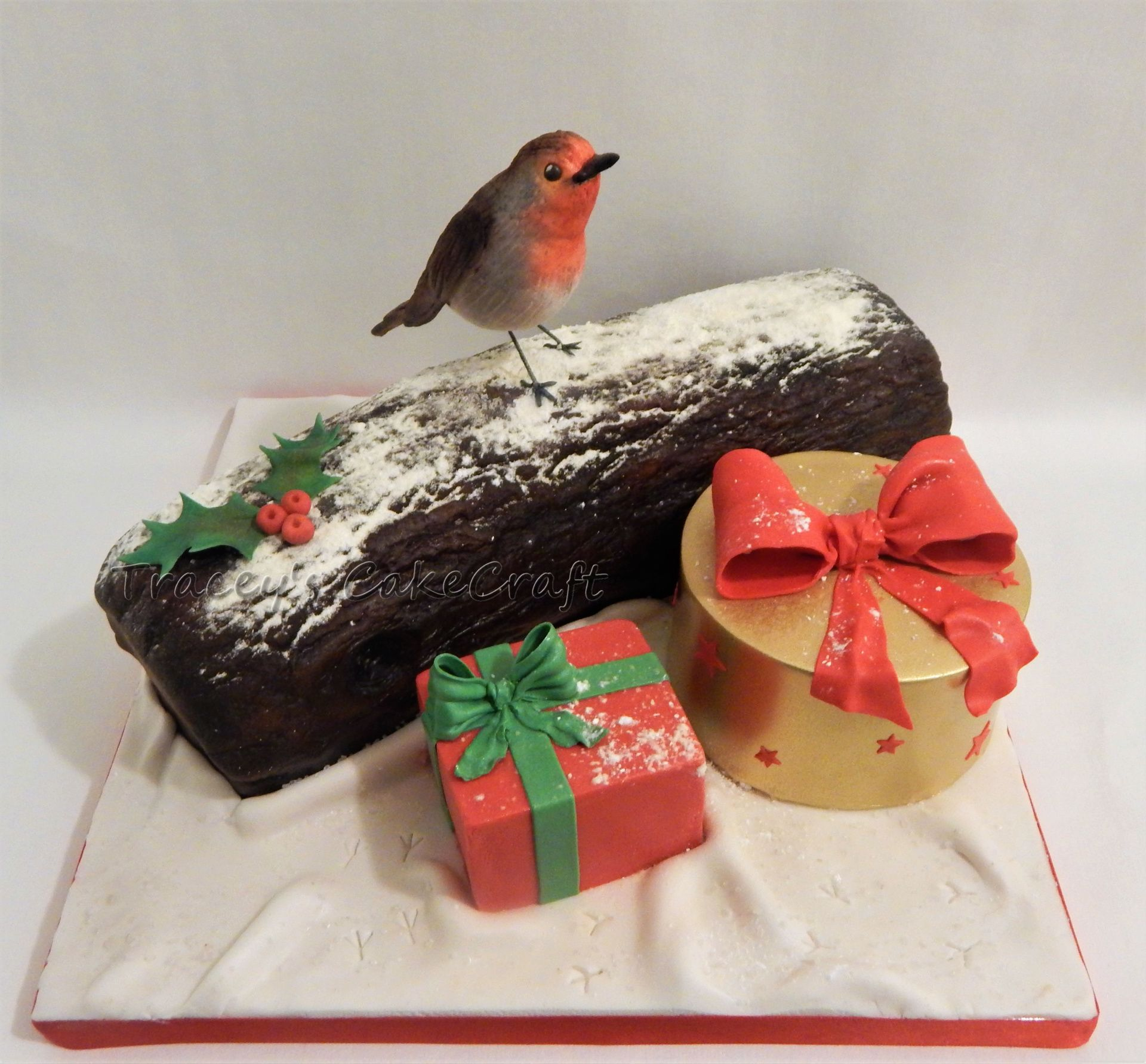 Chocolate Christmas log, cake presents and edible robin