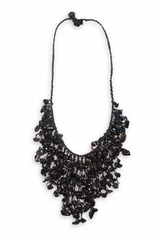 This black chip bead necklace features dangling strands of beads, attached to beautifully braided neckline. This necklace will bring a statement to any outfit! Great addition to your jewelry collection.