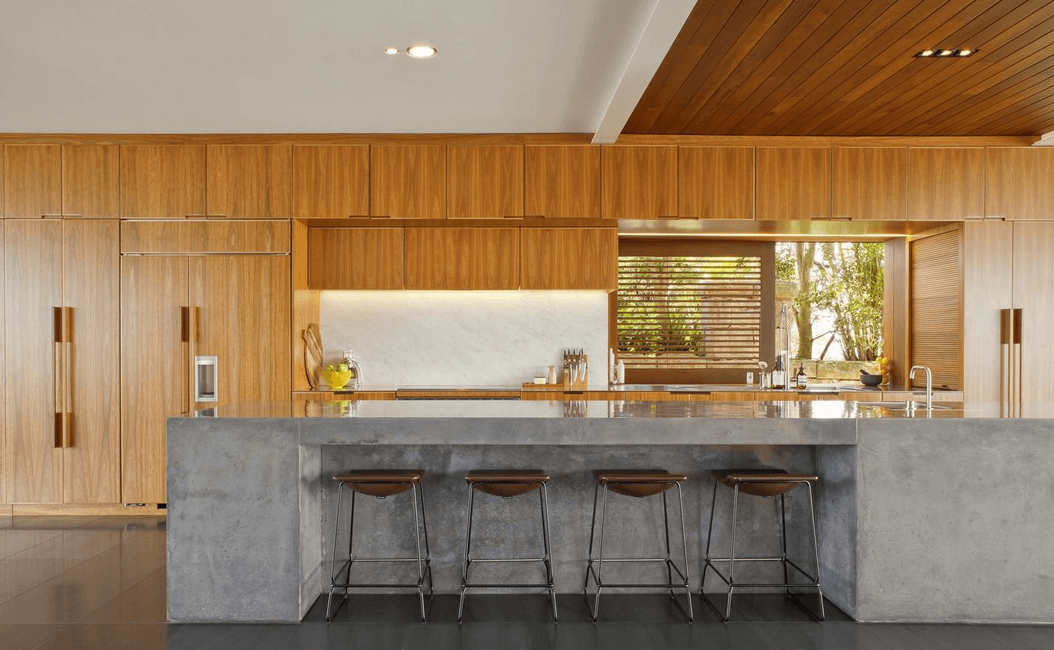 Concrete Island With Wood Cabinets An Island Can Serve Many Purposes From Food Prep To