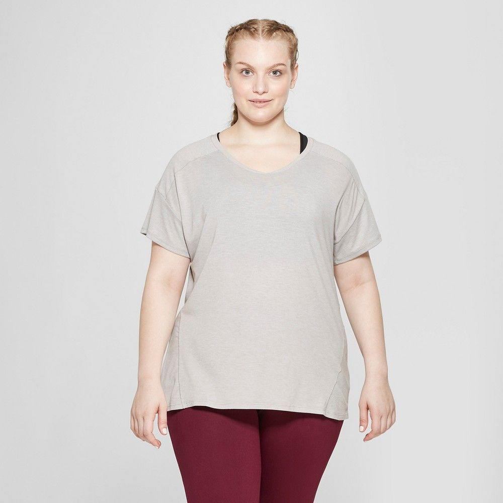 34d9391d07610 The Women s Plus Size Active T-Shirt from C9 Champion features a loose fit  V-neck and drop hem. This short sleeve tee helps keep you cool with  breathable ...
