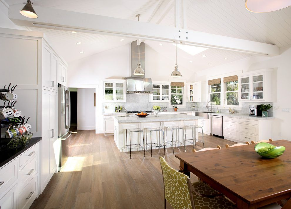 vaulted ceilings in the kitchen large island with pendant lighting and wooden bar chairs on kitchen cabinets vaulted ceiling id=41652