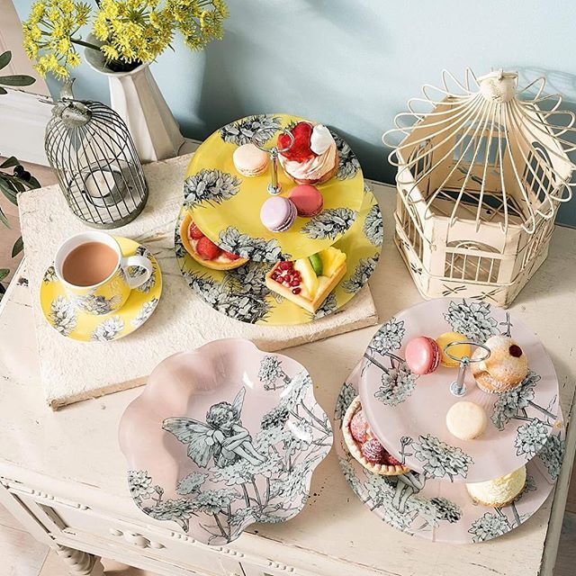 Happy Afternoon Tea Week! For our followers in the UK we're having a giveaway for one of these beautiful cake stands on Facebook, make sure you check it out 😊☕️🍰 #afternoonteaweek #afternoontea #flowerfairy #flowerfairies #cicelymarybarker #teatime #enesco @enescolimited