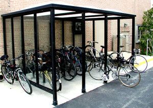 Prefab Bike Shelters. Wall glazing options range from glass panel to aluminum perforated to clear mar resistant polycarbonate. We also have clear acrylic panels available. Accessories include: Leaning rails Ad boxes Display cases for schedules and maps Benches Trash containers Bicycle shelters Lighting Wind skirting