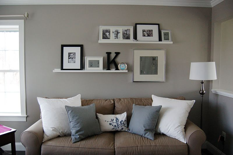 Hanging Ribba picture ledge from IKEA Wall behind couch