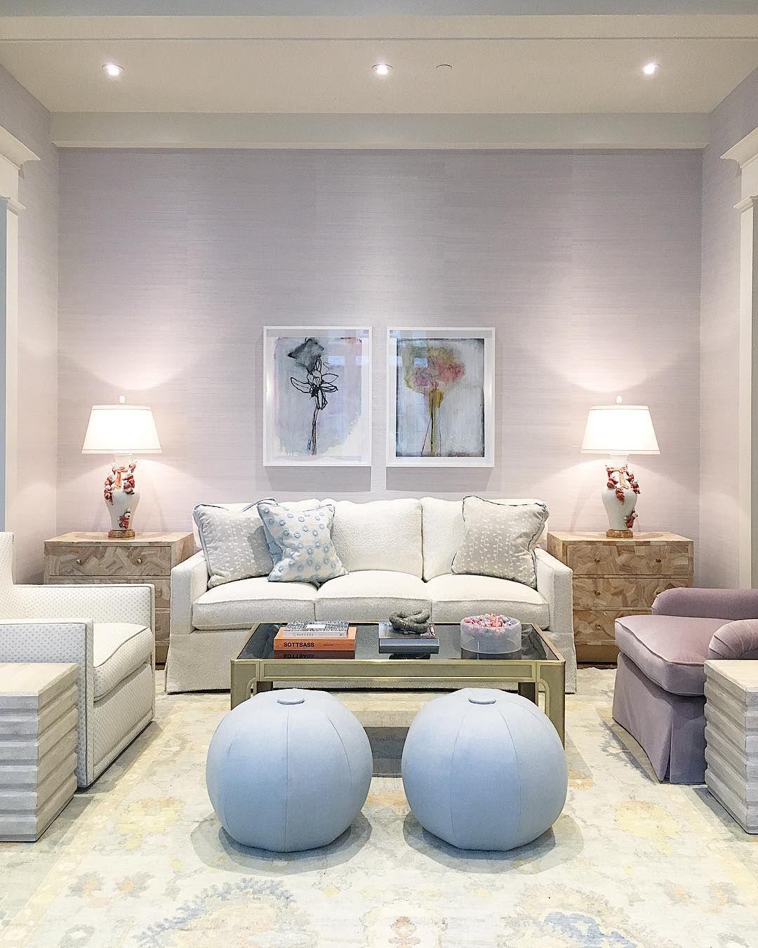 blue stool ottomans | white skirted sofa | light and bright living ...