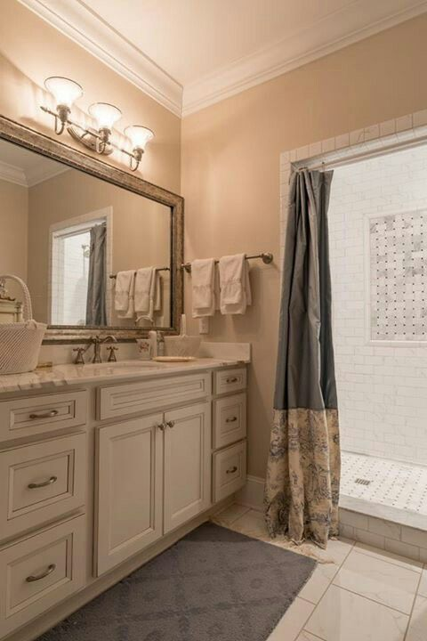 this gorgeous bath is homecrest cabinets laurent maple french vanilla paint with brownstone glaze amerock
