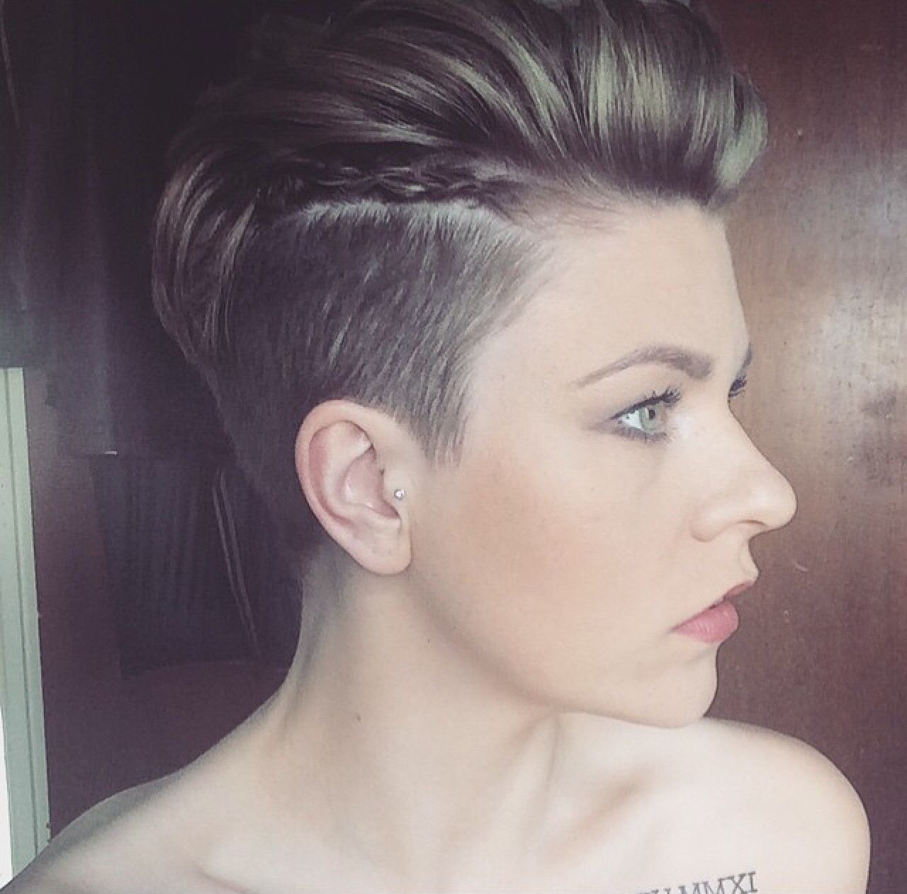 Pixie undercut. Faux hawk with braids. Run a little mousse