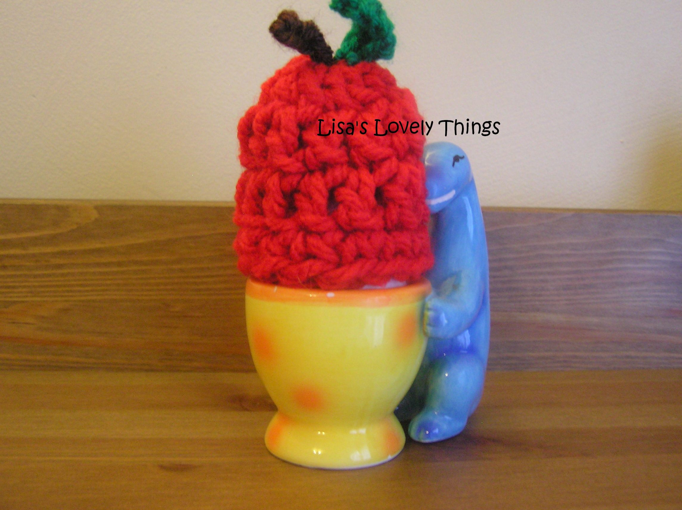 Crochet apple egg cosy made from chunky wool.