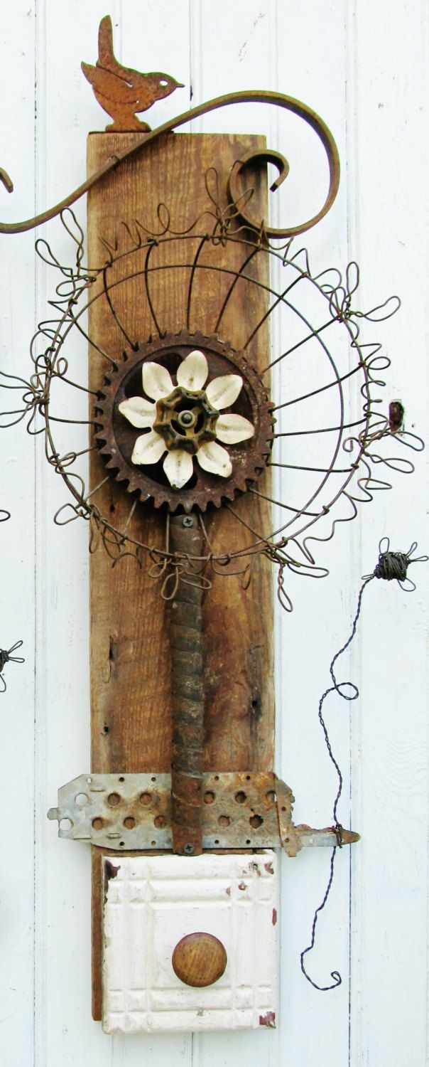 Large assemblage art wall flower on reclaimed wood with rusty