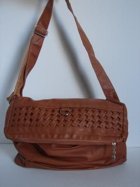 Messenger fold over bag in a cadmium orange tan hue. Silver hardware & zipper. Strap can be adjusted to make this a short purse or a longer bag. Unique & kool bag. Medium size.