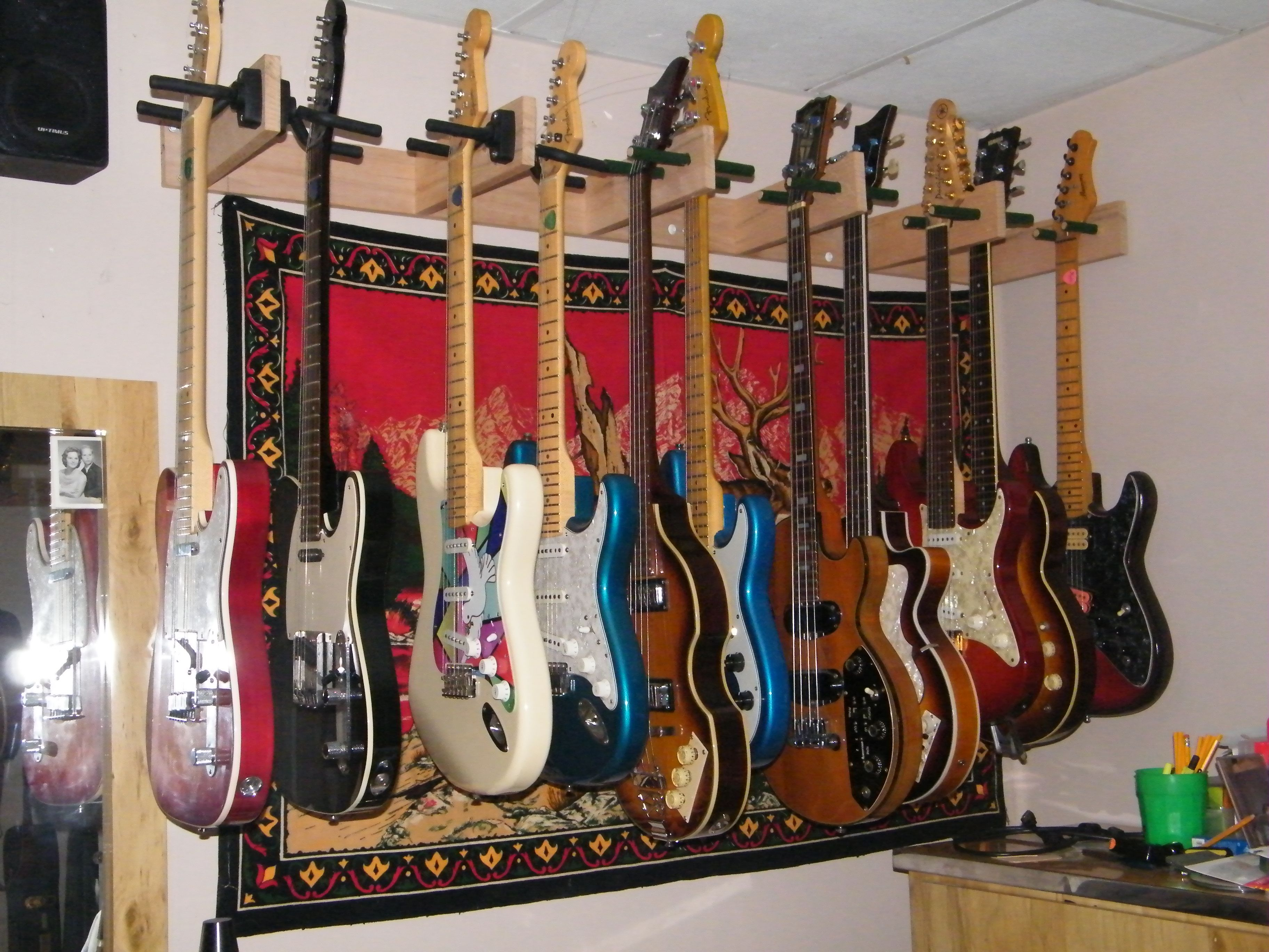 wall mounted guitar rack home projects ideas guitar wall hanger guitar wall guitar storage. Black Bedroom Furniture Sets. Home Design Ideas