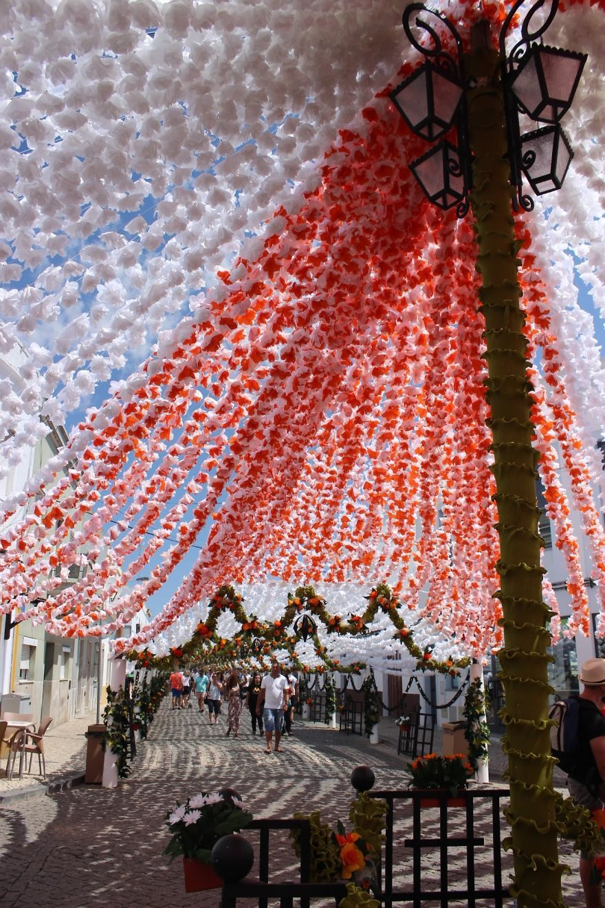 1000s of handmade paper flowers cover the streets of
