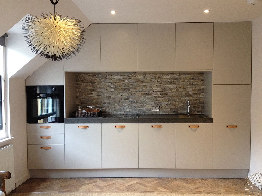 bespoke kitchen with concrete countertop, leather handles