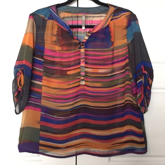 NWOT Multicolor Blouse Super cute for the summer! 3/4 length sleeve slightly sheer blouse that ties at the sleeves, and buttons up in front with orange gold buttons. From smoke and pet free home. Mono B Tops