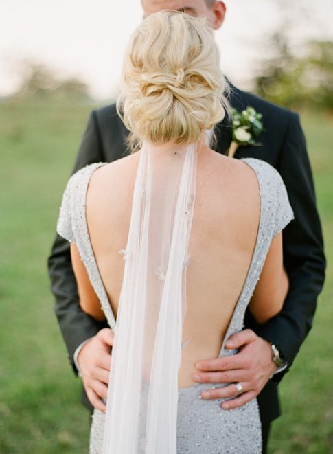 A custom silk tulle vei with handmade and crystal beaded, silver and charcoal flowers