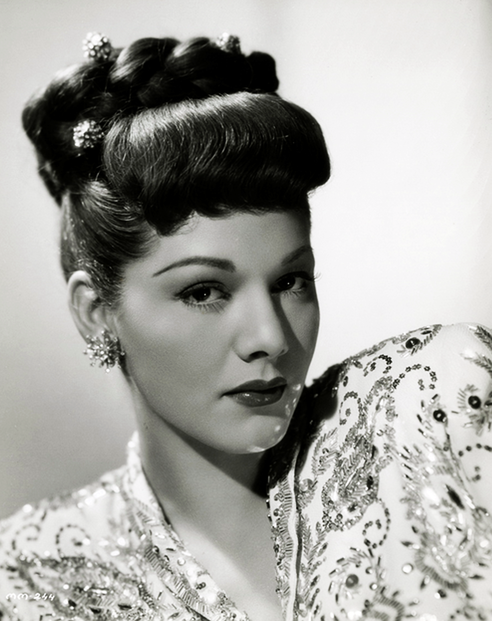 maria montez - love her hair here (bangs + braid). #vintage #1940s