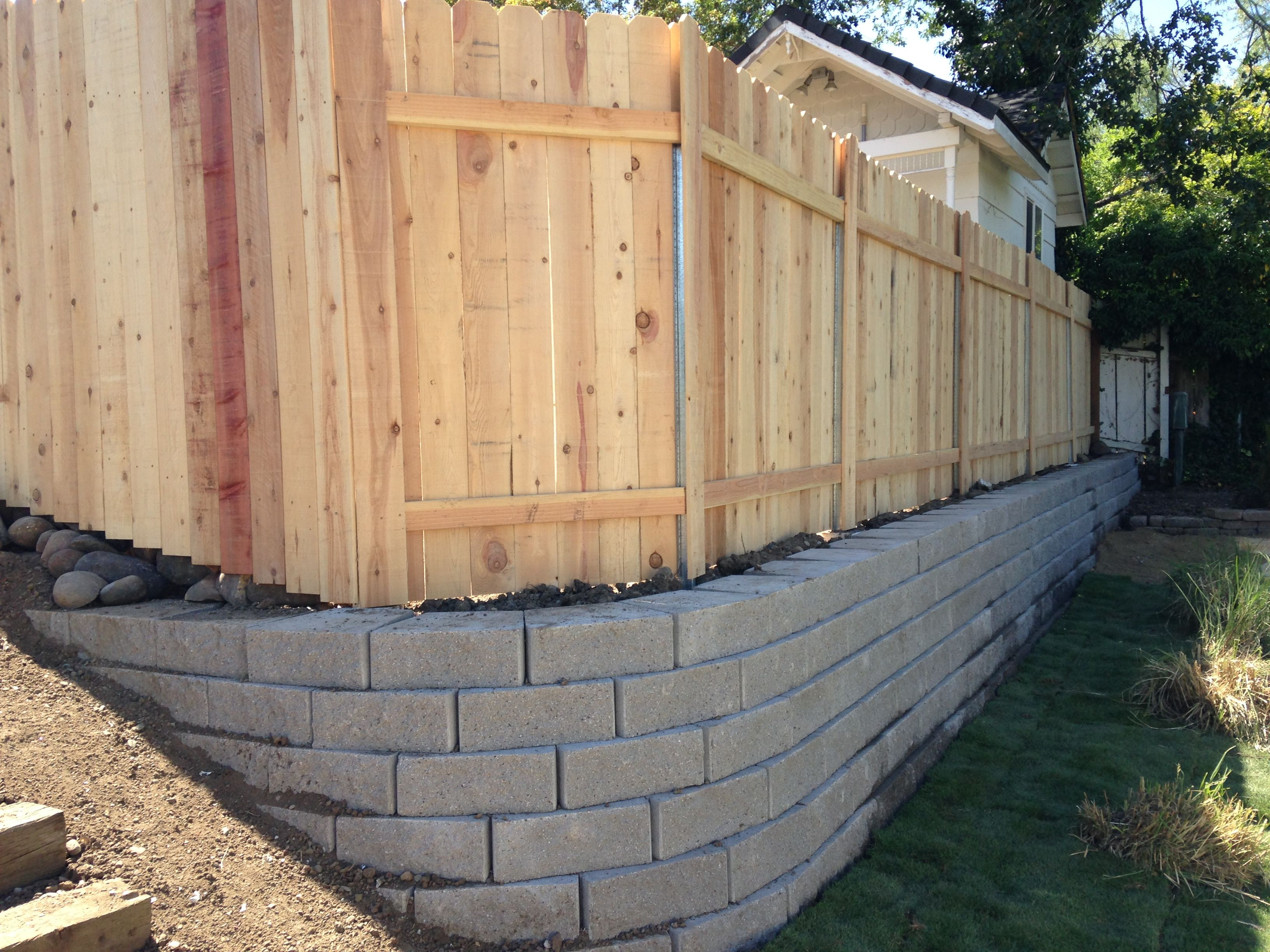 retaining wall with fence on top retaining walls