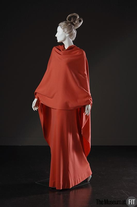 Gres coral wool and angora jersey dress, 1965 France . Simple geometric shapes make this evening ensemble. A simple tubular skirt on top of a tunic, hip length in front and floor length at back. Museum at FIT New York.