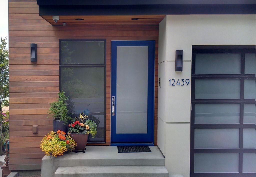 Contemporary front door with ipe siding glass garage door for Modern french doors exterior